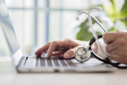 My Health Record - Doctor entering notes on laptop