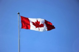 Canada Flag on a clear blue sky